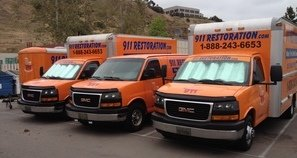 Fire Damage Restoration Fleet At Commercial Job Site