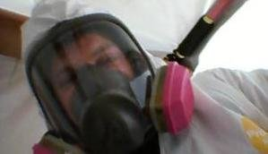 Water Damage Restoration Technician With Gas Mask