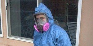 Technician Clearing Out Mold Infested Building