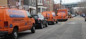 Water Damage and Mold Removal Vehicles At Commercial Job Site