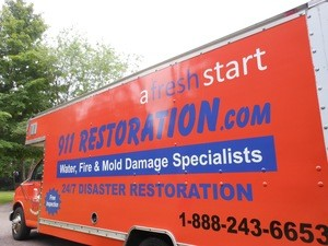 Water Damage Restoration Truck Parked At Residential Job Site